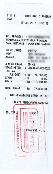 Struk pembayaran tagihan air PAM PDAM Tirta Raharja di Alfamart